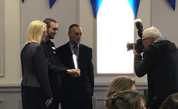 Gary Rushman receiving an award from the Trust's Chairman and Managing Director